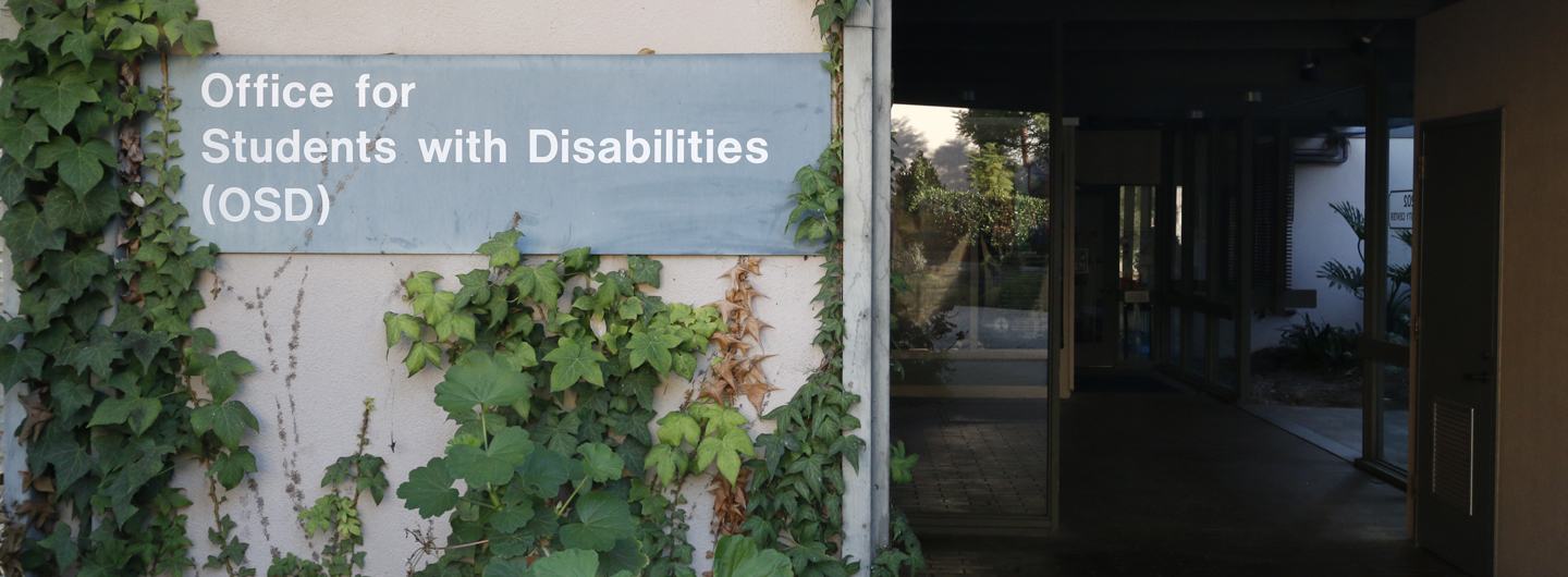 Picture of sign in front of office for students with disabilities entrance
